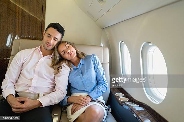 Loving couple traveling in business class