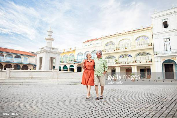 Loving couple walking on the town square