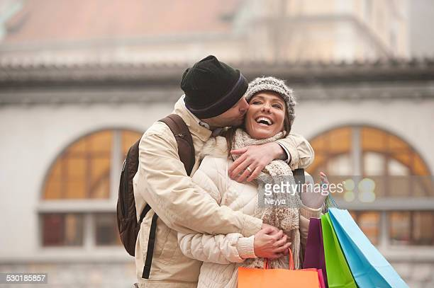 Loving Couple with Shopping Bags in Winter