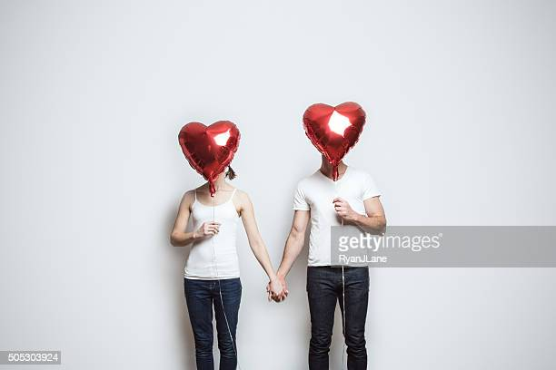 loving couple with valentines day balloons - valentines day couple stock pictures, royalty-free photos & images