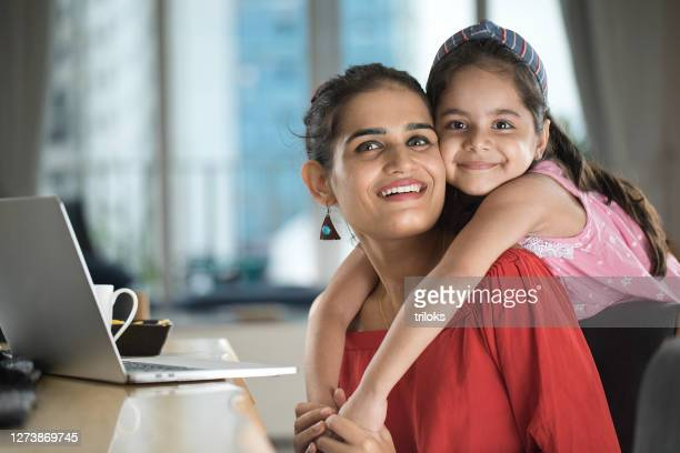 loving daughter embracing mother at home - working mother stock pictures, royalty-free photos & images