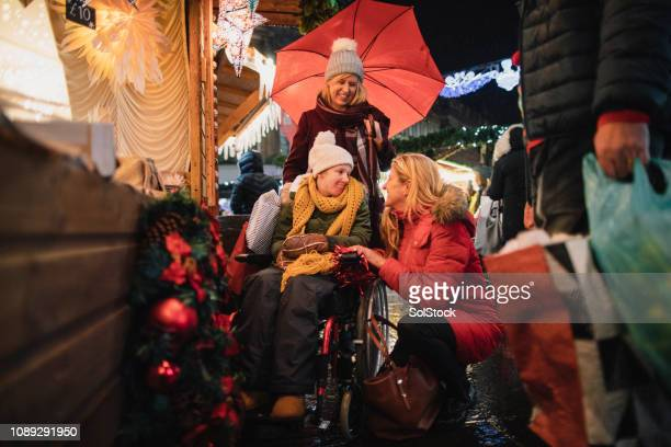 loving family at christmas market - als stock photos and pictures