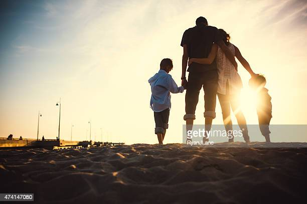 loving family at venice beach - back lit stock pictures, royalty-free photos & images