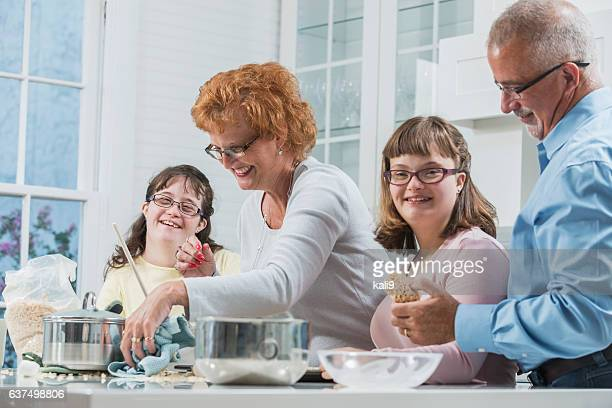 Loving family, daughters with down syndrome, in kitchen