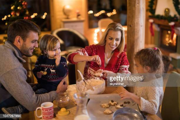 loving family having fun while making cookies on christmas holidays. - dia de ano novo imagens e fotografias de stock