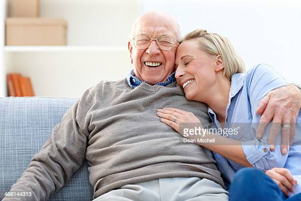 loving father and daughter together on sofa - adults only photos stock pictures, royalty-free photos & images