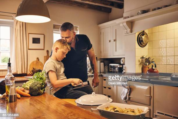 Loving father and son in kitchen
