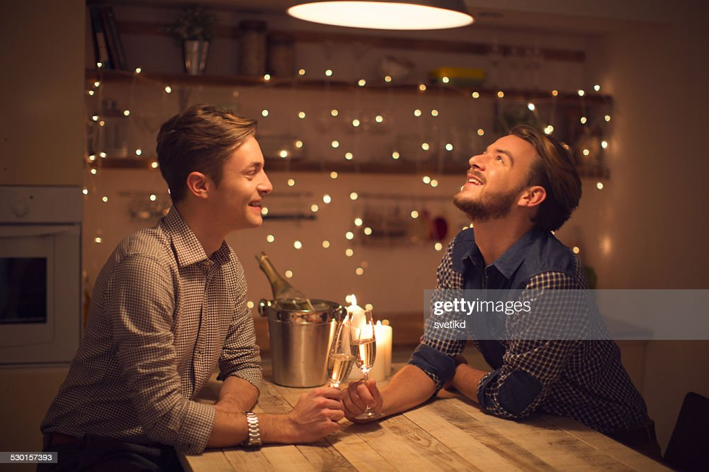 Loving gay couple drinking champagne. : Stock Photo