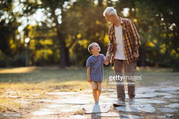 loving grandpa - natural parkland stock pictures, royalty-free photos & images