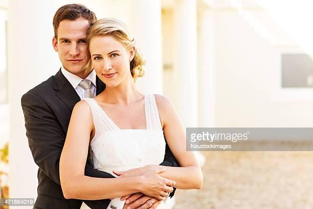 Loving Groom Embracing Bride