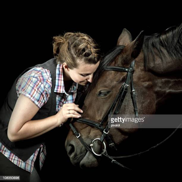 loving her horse - bay horse stock photos and pictures