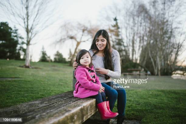 loving hispanic mother spends time with her daughter - mexican mothers day stock photos and pictures