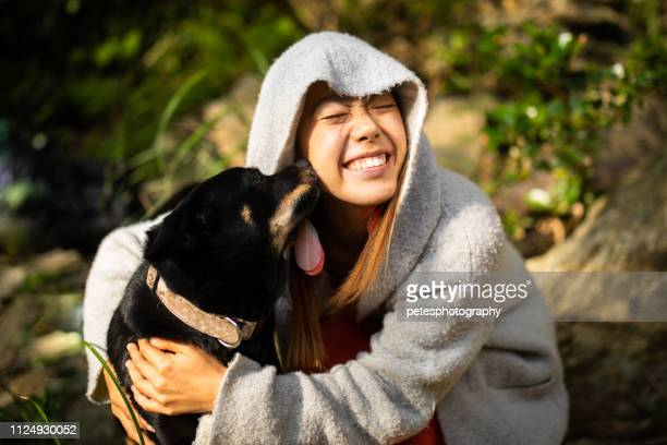 Loving kisses from her dog