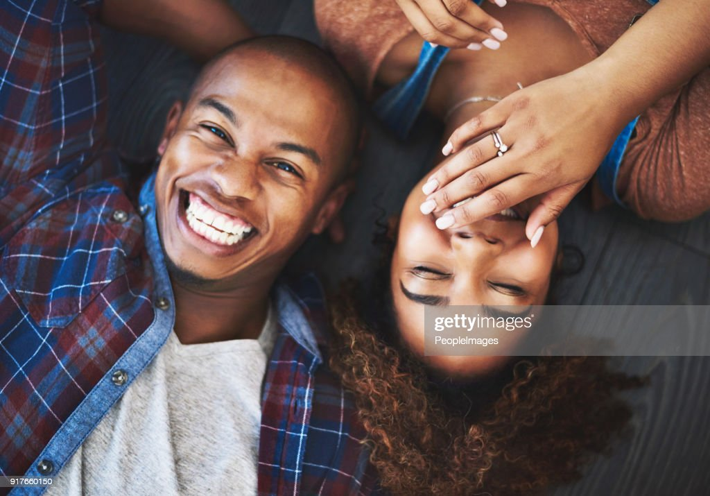 Loving, laughing all at the new place : Stock Photo