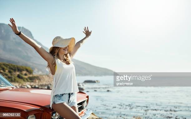 loving life and feeling free - denim shorts stock pictures, royalty-free photos & images