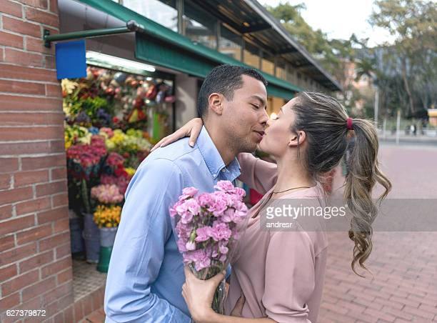 Loving man giving flowers to his girlfriend