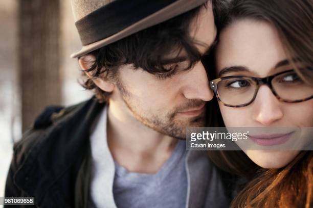 loving man looking at beautiful woman outdoors - somerville massachusetts stock pictures, royalty-free photos & images