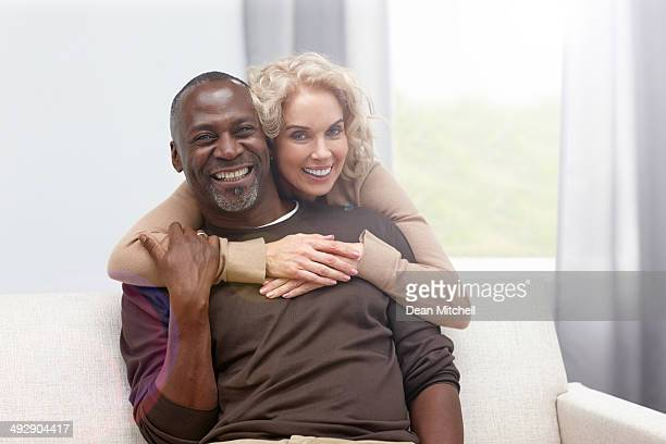 Loving mature couple at home