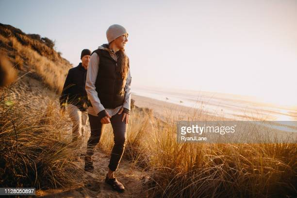 loving mature couple hiking at oregon coast - outdoors stock pictures, royalty-free photos & images