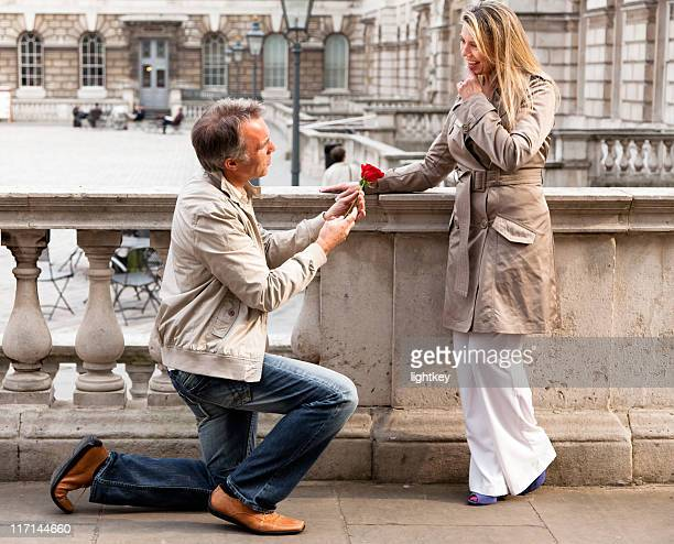 loving mature couple - knees together stock photos and pictures