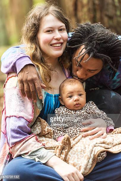 loving mixed race family - black men kissing white women stock photos and pictures