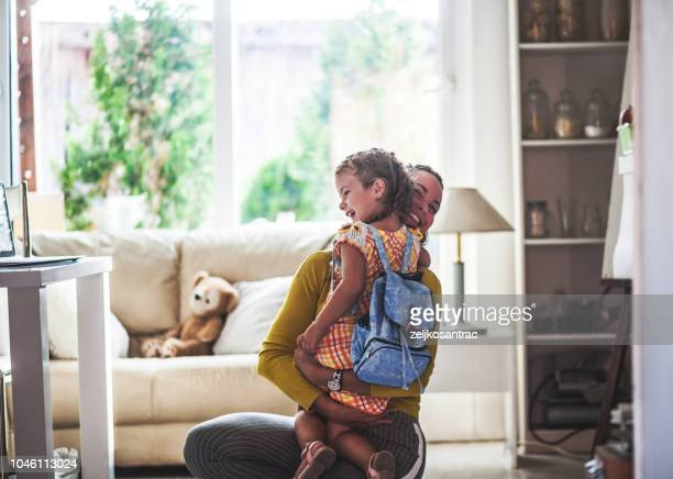 loving mom sends adorable daughter off to school - first day of school stock pictures, royalty-free photos & images