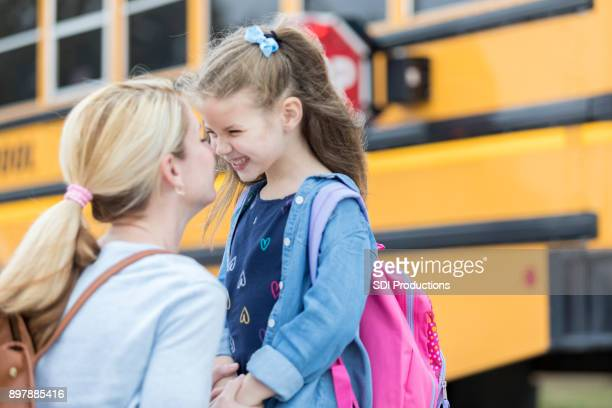 Loving mom sends adorable daughter off to school