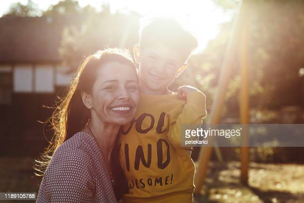 loving mother and son - standing stock pictures, royalty-free photos & images