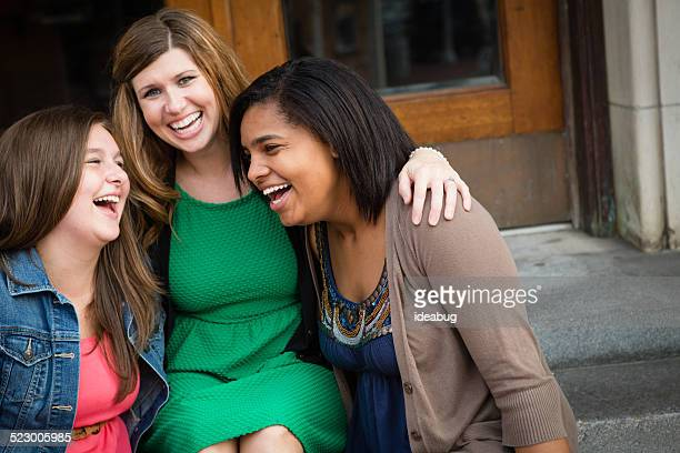 Loving Mother Laughing with Biological and Adopted Daughters