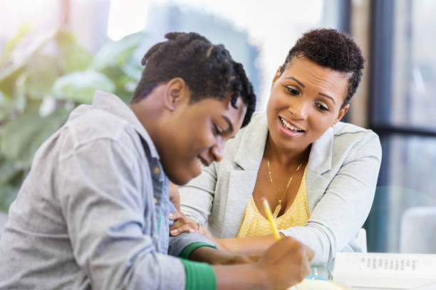 loving mother praises teenage son's homework diligence - parents praise kids stock pictures, royalty-free photos & images