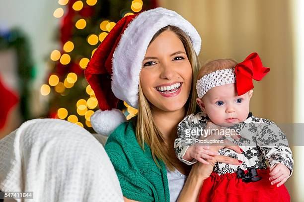 Loving mother with baby girl on Christmas Eve