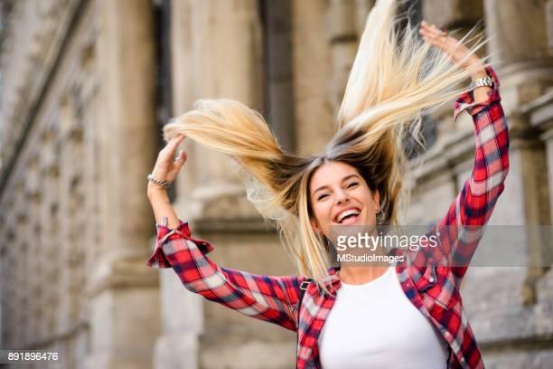 loving my hair. - persona attraente foto e immagini stock