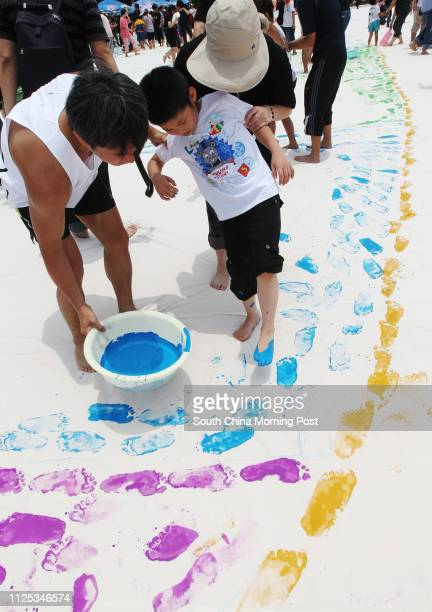 Loving Power and IN56 holds action of Mark My Heartprint in an attempt to break the Guinness World Record for the largest painting made by footprints...