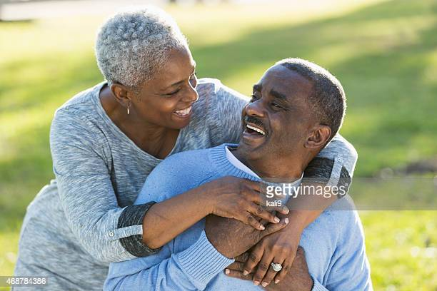 Loving senior African American couple laughing together