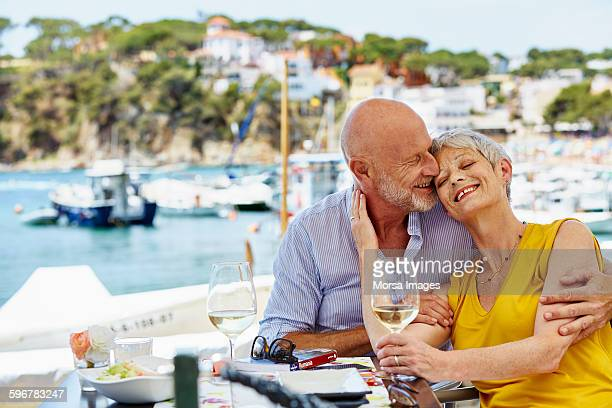 Loving senior couple at restaurant