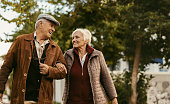 Loving senior couple enjoy a walk together on a winter day