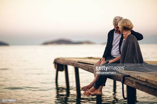 loving senior couple enjoying their life together - pier stock pictures, royalty-free photos & images