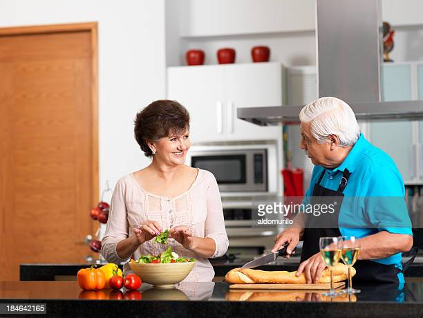Loving senior couple making dinner together