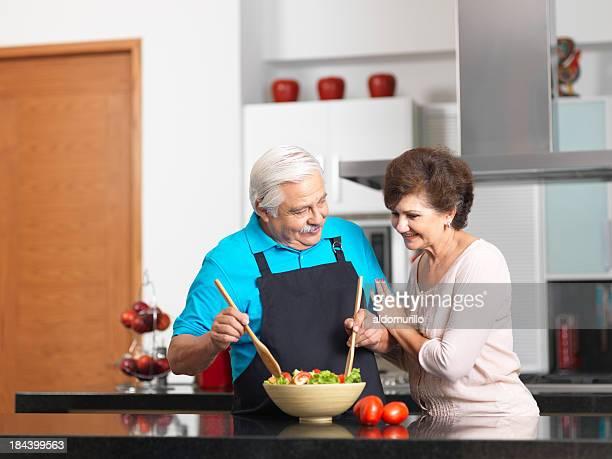 Loving senior couple preparing a healthy salad