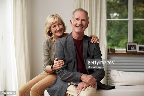 loving senior couple smiling together in cottage - 60 69 jaar stockfoto's en -beelden