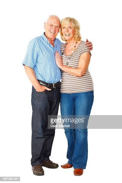Loving senior couple standing together smiling on white