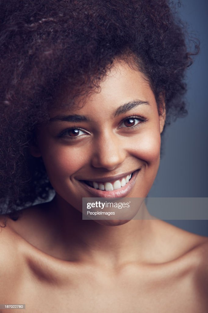 Loving the skin she's in : Stock Photo
