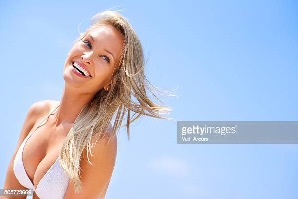 loving the sun on my skin! - candid cleavage stock pictures, royalty-free photos & images