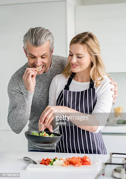 Loving woman cooking for her partner