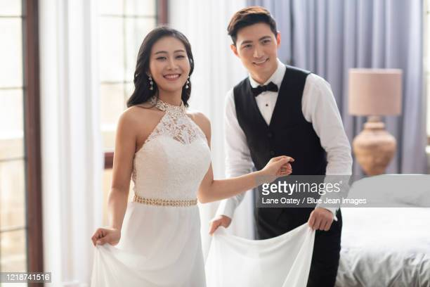 loving young chinese couple at home - 裾 ストックフォトと画像