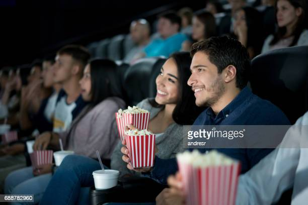 Loving young couple at the movies