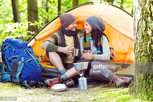 loving young couple camping - izusek stock pictures, royalty-free photos & images