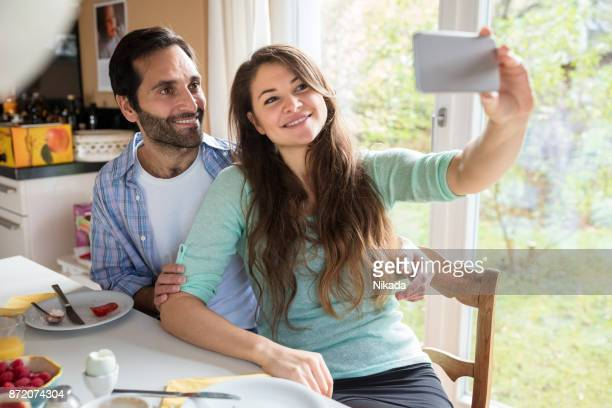 Loving young couple taking a selfie