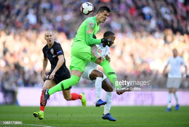 Lovre Kalinic of Croatia collides with Raheem Sterling of England during the UEFA Nations League A group four match between England and Croatia at...