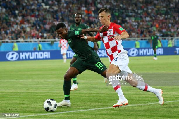 Lovre Kalinic of Croatia is tackled by Ivan Perisic of Croatia during the 2018 FIFA World Cup Russia group D match between Croatia and Nigeria at...